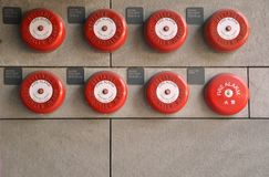 Red Alarms on brick wall Royalty Free Stock Photo