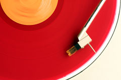 Red album. Close-up of red album on turntable stock photography