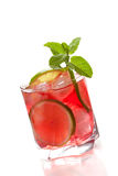 Red alcohol cocktail with lime slices and mint Royalty Free Stock Image