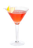 Red alcohol cosmopolitan cocktail decorated with citrus lemon in Royalty Free Stock Photo
