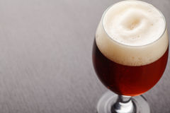 Red ale on dark table Royalty Free Stock Photography