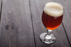 Red ale on dark wood Stock Image