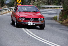 Red Alfa Romeo Cornering. Red Alfa Romeo Coupe mid corner on the Bay to Birdwood Run in the Adelaide Hills., 28 September 2008 Royalty Free Stock Photography