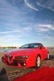 Red Alfa Romeo sports car Stock Images