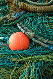 Red all amongst green fishing nets Royalty Free Stock Photography