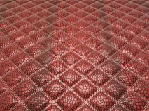 Red Alligator skin with stitched rectangles. Useful as background Stock Photography