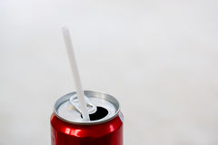 Red aluminium can and straw. Red aluminium can,straw on sparking water can. sweet drinking. un-healthy food concept stock images