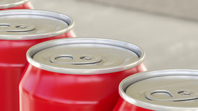 Red aluminum cans on industrial conveyor. Soda or beer production line. Recycling ecologic packaging. 3D rendering Royalty Free Stock Images