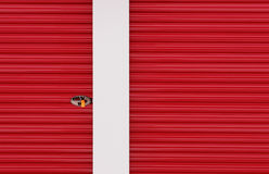 Red Aluminum Door. Abstract view of red aluminum door and lock Royalty Free Stock Images