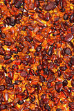 Red amber stones lie on a flat surface. Oblong red amber stones lie on a flat surface Stock Photos