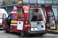 Red ambulance. Red modern ambulance with open doors ready for action Royalty Free Stock Photo