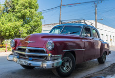 Red american classic car parked on the street in Santa Clara Cuba Stock Image