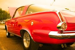 Red American muscle car. Rear end of American muscle car in warm color tone Stock Photos