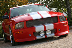 Red american muscle car. With white stripe at an angle Stock Photography
