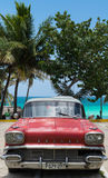 Red american vintage car parked on the beach in Varadero Cuba Stock Image