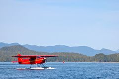 Red amphibious plane on a lake Stock Photography