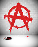 Red anarchy sign graffiti on brick wall Royalty Free Stock Photography