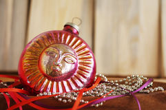 Red ancient New Year's toy on bright brilliant jewelry Stock Images