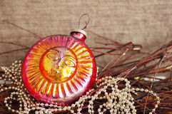 Red ancient New Year's toy on bright brilliant jewelry Stock Image