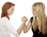 Red And Blond Haired Girls Battle Each Other Stock Image