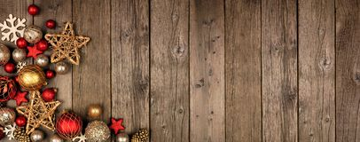 Free Red And Gold Christmas Ornament Corner Border Banner, Above View On A Wood Background Stock Image - 163688331