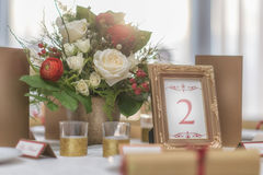 Free Red And Ivory Floral Arrangement Prepared For Reception, Wedding Table With Candle And Setting, Winter Concept Royalty Free Stock Photography - 88416167
