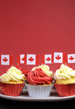 Red And White Cupcakes With Canadian Maple Leaf National Flags - Vertical With Copyspace. Royalty Free Stock Photography