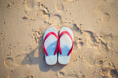 Free Red And White Sandal On The Beach Stock Image - 93517121