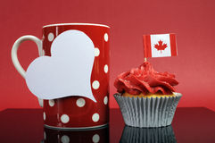 Red And White Theme Canadian Cupcake With Maple Leaf Flag And Red Polka Dot Coffe Mug Stock Image