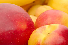Red And Yellow Background Of Fruits Stock Photo