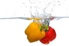 Red And Yellow Bell Pepper Splashing Royalty Free Stock Image
