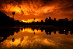 Red Angkor Wat Dawn Sunrise from reflection pool Stock Photos