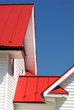 Red angles. White building with bright red roof royalty free stock photos