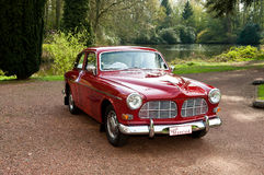 A red antique car. A red oldtimer used as wedding car with as license plate just married Stock Images