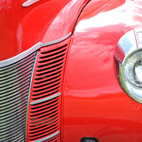 Red antique car extreme closeup royalty free stock image