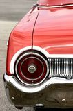 Red antique convertible automobile round tail light. Red antique convertible automobile with round tail lights Royalty Free Stock Photography