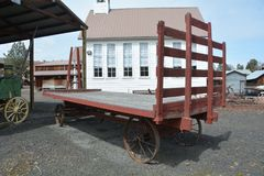 Red Antique Farm Wagon in Dufur, Oregon. This is a red antique farm wagon on display in Dufur, Oregon stock photo