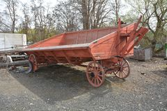 Red Antique Farm Wagon with sloping sides in Dufur, Oregon. This is a red antique farm wagon with sloping sides in Dufur, Oregon royalty free stock photo