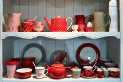 Red antique porcelain utensils in sideboard Royalty Free Stock Photography