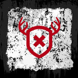 Red antler shield design. Red antler shield emblem on a gray grunge background Stock Photo