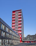 Red apartment building Stock Photos
