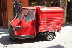 Red Ape Van. Bologna, Italy – July 17, 2013: Red Piaggio Ape vehicle on the street in Bologna, Italy royalty free stock image