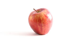 Red Apple. Brilliant red apple on white backdrop royalty free stock images