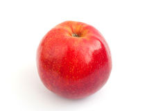 Red apple. One is yellow - a red apple with a shank on a white background Royalty Free Stock Images