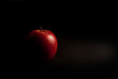 Red apple. On a black background Stock Images
