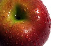 Red apple. A red apple whit fersh drops of water Stock Image