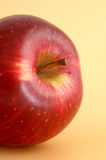 Red Apple. Close-up shot of a red apple, with yellow background Stock Photos