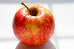 Red apple. Healthy orange-red apple on a white background Stock Images