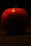 Red Apple. A red apple on a black background Royalty Free Stock Image