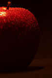Red Apple. A red apple on a black background Royalty Free Stock Photo